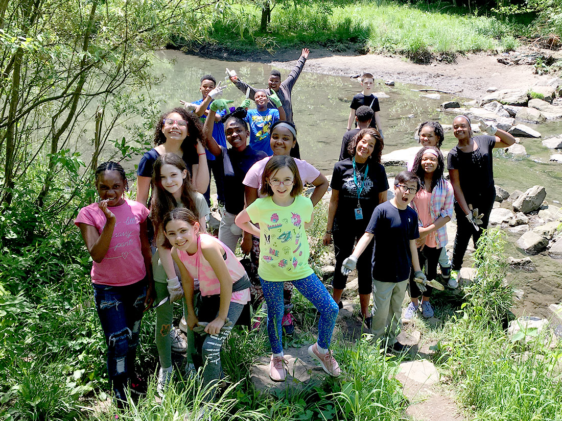 Group of students at Nine Mile Run Stream