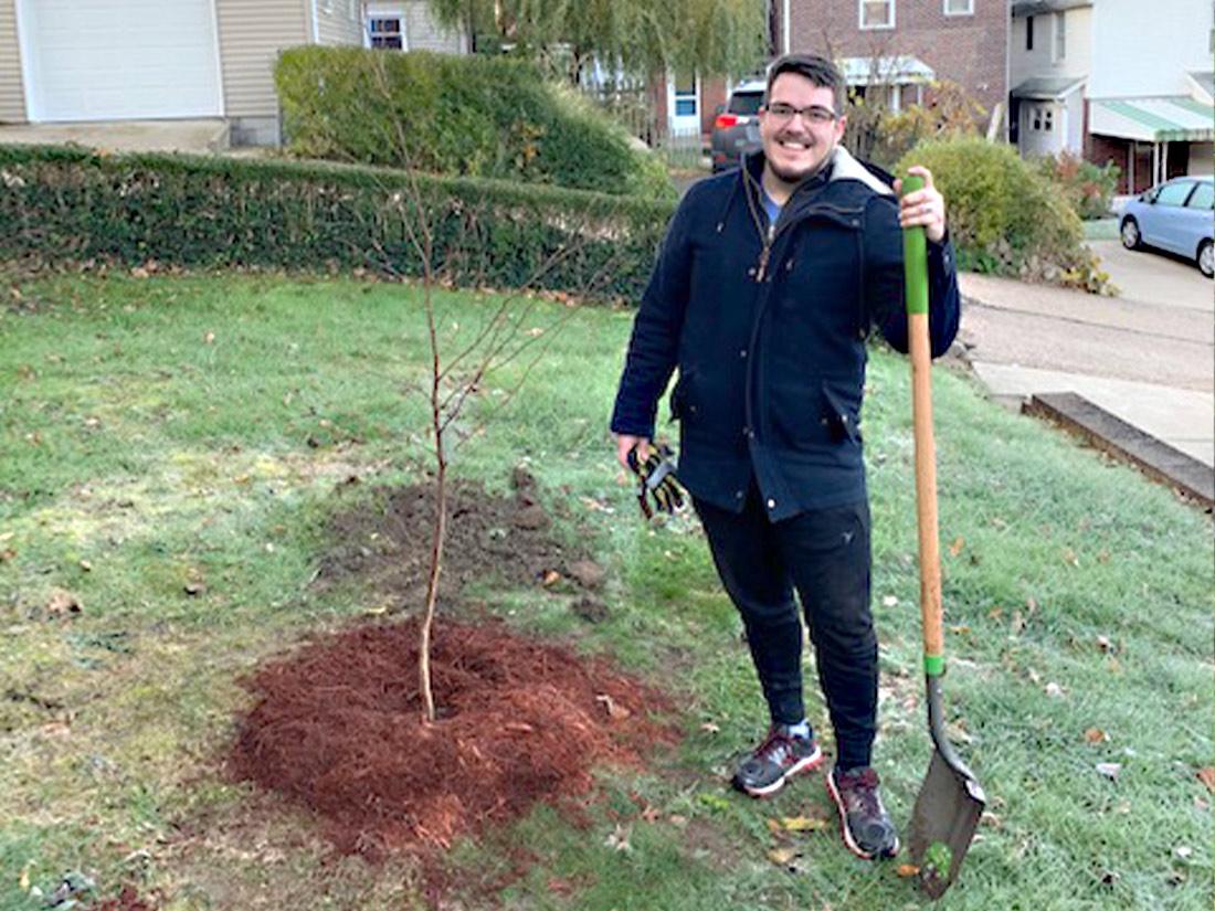 Citizen planting tree Pittsburgh PA