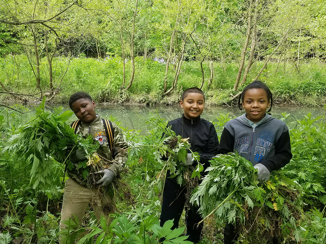 Woodland Hills students with greenery