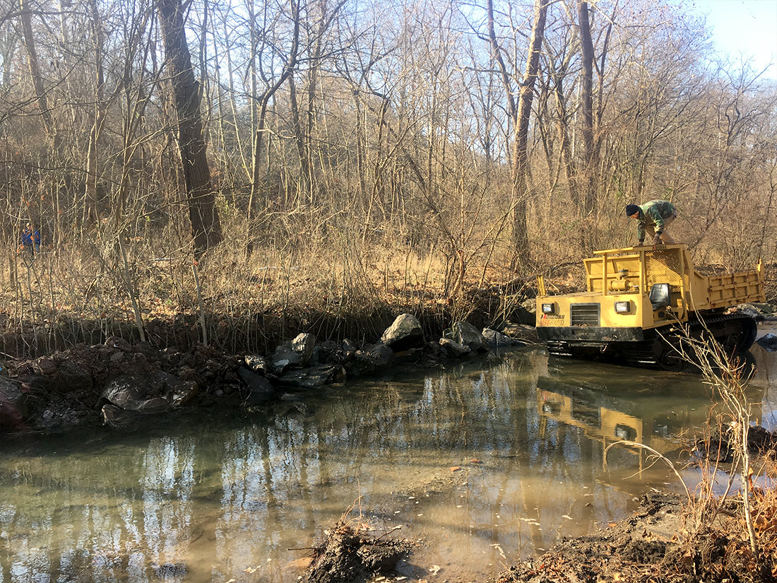 Dump truck for removing large rocks from Nine Mile Run stream in Pittsburgh PA