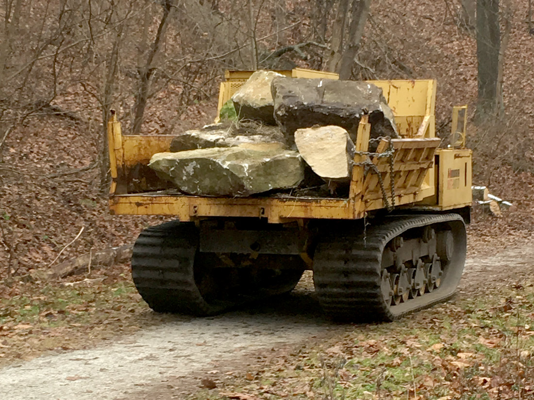 Dump truck hauling away large rocks for stream restoration in Pittsburgh PA