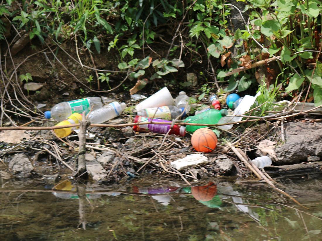 Plastic garbage floating in Nine Mile Run